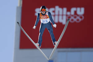 Photo - United States' Taylor Fletcher makes his trial jump during the ski jumping portion of the Nordic combined at the 2014 Winter Olympics, Wednesday, Feb. 12, 2014, in Krasnaya Polyana, Russia. (AP Photo/Matthias Schrader)