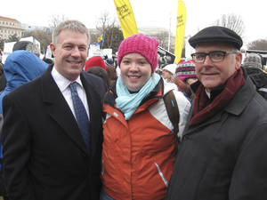 Photo - Oklahoma City attorney Kevin Calvey, left, Abby Pollart, of Lawton, and Oklahoma City Archbishop Paul Coakley pause Friday during the anti-abortion march in Washington. Photo by  Chris Casteel, The Oklahoman