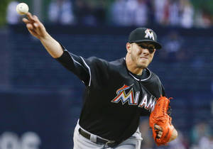 Photo - Miami Marlins starting pitcher Jose Fernandez works the first inning against the San Diego Padres during a baseball game on Friday, May 9, 2014, in San Diego. (AP Photo/Lenny Ignelzi)