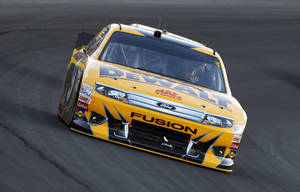 photo -   Marcos Ambrose drives out of Turn 4 during the NASCAR Coca-Cola 600 Sprint Cup Series auto race in Concord, N.C., Sunday, May 27, 2012. (AP Photo/Terry Renna)