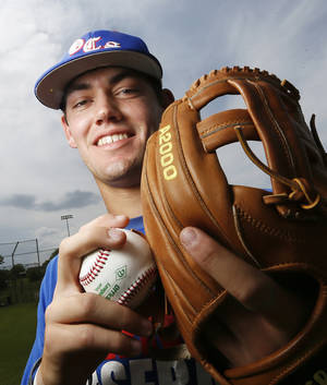 Photo - Oklahoma Christian School's Austin Brooks poses for a photo at the OCS baseball field in Edmond, Okla.,  Wednesday, May 8, 2013. Photo by Nate Billings, The Oklahoman