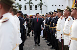 Photo -   In this photo provided by Miraflores Presidential Press Office, Venezuela's President Hugo Chavez, center, attends a military ceremony at Fuerte Tiuna in Caracas, Venezuela, Sunday, July 8, 2012. (AP Photo/Miraflores Presidential Office)