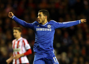 Photo - Chelsea's Eden Hazard, right, celebrates his goal during their English Premier League soccer match against Sunderland at the Stadium of Light, Sunderland, England, Wednesday, Dec. 4, 2013. (AP Photo/Scott Heppell)