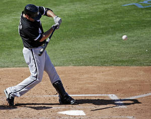 photo - Chicago White Sox's Paul Konerko hits a home run during the fourth inning of an exhibition spring training baseball game against the Chicago Cubs, Thursday, March 7, 2013, in Mesa, Ariz. (AP Photo/Morry Gash)