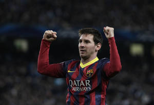 Photo - Barcelona's Lionel Messi celebrates after he scores the first goal of the game from a penalty during the Champions League first knock out round soccer match between Barcelona and Manchester City at the Etihad Stadium, Manchester, England, Tuesday Feb. 18, 2014. (AP Photo/Jon Super)