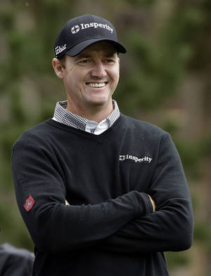 Photo - Jimmy Walker smiles as he waits to hit off the seventh tee on Friday, Feb. 7, 2014, during the second round of the AT&T Pebble Beach Pro-Am golf tournament on the Spyglass Hill Golf Course in Pebble Beach, Calif. (AP Photo/Ben Margot)