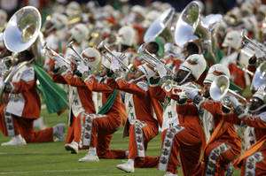 Photo - The Florida A&M University band performs on the field before the NFL Super Bowl XLIV football game between the Indianapolis Colts and New Orleans Saints in Miami, Sunday, Feb. 7, 2010. (AP Photo/Rob Carr) ORG XMIT: SB183