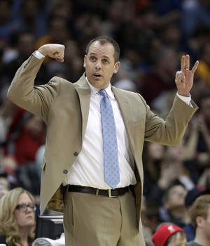 Photo - Indiana Pacers head coach Frank Vogel makes a sign for his team during the third quarter of an NBA basketball game against the Cleveland Cavaliers Sunday, March 30, 2014, in Cleveland. Cleveland defeated Indiana 90-76. (AP Photo/Tony Dejak)