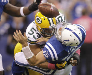 photo -   Indianapolis Colts quarterback Andrew Luck (12) is hit by Green Bay Packers outside linebacker Nick Perry (53) during the first half of an NFL football game in Indianapolis, Sunday, Oct. 7, 2012. Perry was called for unnecessary roughness. (AP Photo/Michael Conroy)