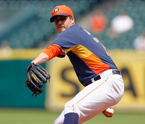 Photo - Houston Astros' Mark Appel throws in the first inning of a spring exhibition baseball game against Rojos del Aguila de Veracruz on Sunday, March 30, 2014, in Houston. (AP Photo/Bob Levey)