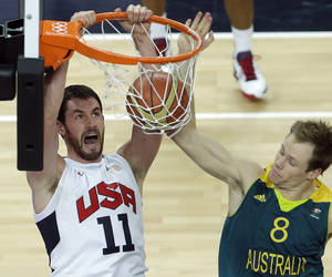 photo -   FILE - In this Aug. 8, 2012, fil ephoto, United States' Kevin Love, left, dunks as Australia's Brad Newley, right, defends during a men's quarterfinal basketball game at the 2012 Summer Olympics in London. Love is back in Minnesota after a summer highlighted by an Olympic gold medal. He's gearing up for one of the most anticipated seasons in the Timberwolves' hardscrabble history, with training camp starting next week. (AP Photo/Victor R. Caivano, File)