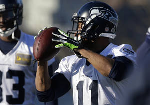 Photo - Seattle Seahawks wide receiver Percy Harvin (11) catches the football during warm-up drills before NFL football practice, Thursday, Jan. 23, 2014, in Renton, Wash. The Seahawks will play the Denver Broncos Feb. 2, 2014 in the Super Bowl. (AP Photo/Ted S. Warren)