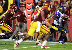 Photo - Northern Iowa running back David Johnson (7) makes his way to the end zone for his second touchdown during the first half of their NCAA college football game against Iowa State in Ames, Iowa Saturday, Aug. 31, 2013. (AP Photo/Justin Hayworth)