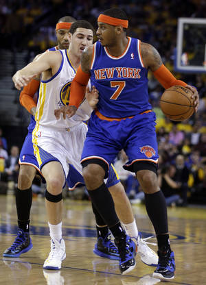 photo - New York Knicks&#039; Carmelo Anthony (7) drives the ball against Golden State Warriors&#039; Klay Thompson during the first half of an NBA basketball game Monday, March 11, 2013, in Oakland, Calif. (AP Photo/Ben Margot)