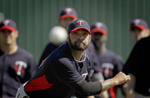 Photo -   Minnesota Twins relief pitcher Joel Zumaya throws a pitch during a baseball spring training workout Friday, Feb. 24, 2012, in Fort Myers, Fla. (AP Photo/David Goldman)