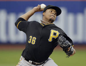 Photo - Pittsburgh Pirates' Edinson Volquez delivers a pitch during the first inning a baseball game against the New York Mets on Tuesday, May 27, 2014, in New York. (AP Photo/Frank Franklin II)