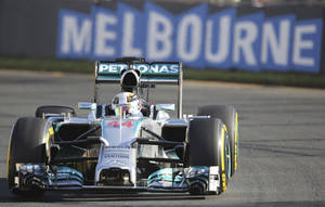 Photo - Mercedes driver Lewis Hamilton of Britain controls his car on turn five during the second practice session at Albert Park ahead of the Australian Formula One Grand Prix in Melbourne, Australia, Friday, March 14, 2014. Hamilton clocked the fastest time ahead of team mate Nico Rosberg. (AP Photo/Rob Griffith)