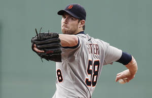 Photo - Detroit Tigers starting pitcher Doug Fister delivers against the Boston Red Sox during the first inning of a baseball game at Fenway Park in Boston Monday, Sept. 2, 2013. (AP Photo/Winslow Townson)