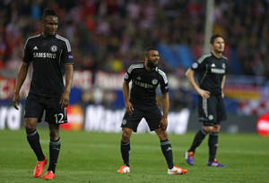 Photo - Chelsea players from left: John Obi Mikel, Ashley Cole and Frank Lampard line up during the Champions League semifinal first leg soccer match between Atletico Madrid and Chelsea at the Vicente Calderon stadium in Madrid, Spain, Tuesday, April 22, 2014. (AP Photo/Andres Kudacki)