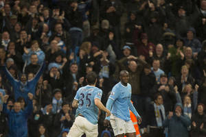 Photo - Manchester City's Yaya Toure, right, celebrates with teammate Stevan Jovetic after scoring against Aston Villa during their English Premier League soccer match at the Etihad Stadium, Manchester, England, Wednesday May 7, 2014. (AP Photo/Jon Super)