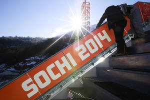 Photo - The sun rises at the RusSki Gorki Jumping Center of the Sochi 2014 Winter Olympics, Saturday, Feb. 1, 2014, in Krasnaya Polyana, Russia, where the snow and sliding sports venues for the 2014 Winter Olympics are located. (AP Photo/Gero Breloer)