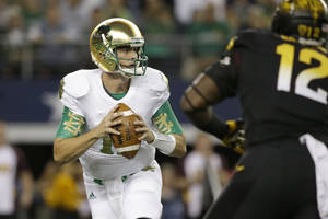 Photo - Notre Dame quarterback Tommy Rees looks to pass under pressure from Arizona State defensive lineman Marcus Hardison (12) during the first half of an NCAA college football game Saturday, Oct. 5, 2013, in Arlington, Texas. (AP Photo/LM Otero)