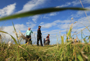 photo - Tiger Woods of the United States watches his tee shot on the 15th hole as playing partner Northern Ireland's Darren Clarke, left, looks on during the third round of the British Open Golf Championship on the Old Course at St. Andrews, Scotland, Saturday, July 17, 2010. (AP Photo/Jon Super)