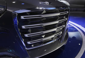 photo - The front grill of the Hyundai HCD-14 Genesis Concept is displayed at the North American International Auto Show in Detroit, Tuesday, Jan. 15, 2013. Hyundais new luxury concept car shows off at least a dozen small inverted triangles that appear behind horizontal bars. The wide-mouth grille has a bunch of tiny holes, and the angles reflect light. Its just one of many new styling cues on the HCD-14 Genesis, which Hyundai says is the direction it will take the next generation of its luxury cars, the Genesis and Equus. (AP Photo/Carlos Osorio) ORG XMIT: MICO120