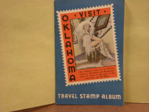 Photo -  A copy of the Oklahoma travel stamp album found at the Oklahoma History Center. Photo by Mary Phillips  <strong></strong>