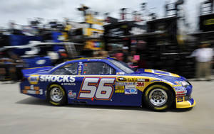 Photo -   Martin Truex Jr. drives his car through the garage area during practice for Sunday's NASCAR Sprint Cup Series auto race at Atlanta Motor Speedway, Friday, Aug. 31, 2012, in Hampton, Ga. (AP Photo/Rainier Ehrhardt)