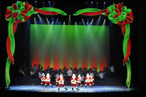 "Photo - A line of dancing Santas at the Oklahoma City Philharmonic's ""The Christmas Show.""   Photo by Wendy Mutz <strong>Photo by Wendy Mutz</strong>"