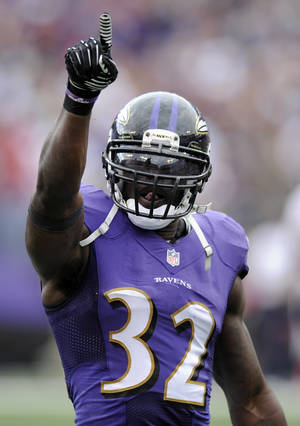 Photo - Baltimore Ravens strong safety James Ihedigbo reacts after tackling Houston Texans running back Arian Foster in the second half of an NFL football game, Sunday, Sept. 22, 2013, in Baltimore. Baltimore won 30-9. (AP Photo/Nick Wass)
