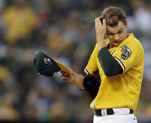 Photo - Oakland Athletics starting pitcher Sonny Gray (54) adjusts his cap after loading the bases in the fourth inning of Game 5 of an American League baseball division series against the Detroit Tigers in Oakland, Calif., Thursday, Oct. 10, 2013. (AP Photo/Ben Margot)