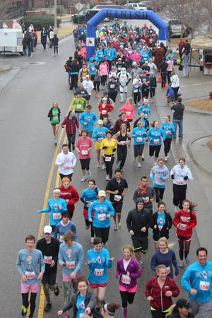Photo - Left: Edmond Memorial High School's first Swine Week Hog Jog 5k in Bricktown brought out 400 runners.