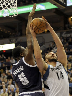 photo - Minnesota Timberwolves&#039; Nikola Pekovic (14), of Montenegro, shoots against Oklahoma City Thunder&#039;s Kendrick Perkins (5) during the first quarter of an NBA basketball game at the Target Center on Thursday, Dec. 20, 2012, in Minneapolis. (AP Photo/Hannah Foslien)