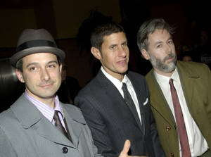 "Photo - FILE - In this March 28, 2006 file photo, members of the Beastie Boys, from left, Adam Horovitz, known as Adrock, Michael Diamond, known as Mike D and Adam Yauch, known as MCA, arrive at the premiere of their new film ""Awesome; I ... Shot That!"" in New York.  The film, which documents a 2004 Beastie Boys concert at New York's Madison Square Garden, is comprised of footage shot by 50 fans who were given cameras to record the show. Yauch, the gravelly voiced Beastie Boys rapper who co-founded the seminal hip-hop group, has died at age 47. The cause of death wasn't immediately known. Yauch, who's also known as MCA, was diagnosed with a cancerous parotid gland in 2009. (AP Photo/Jason DeCrow, file) ORG XMIT: NYET246"