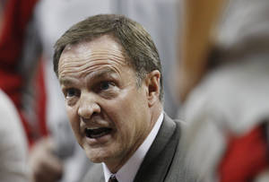 Photo - UNLV's coach Lon Kruger instructs his team during the first half of an NCAA college basketball game against BYU Wednesday, Jan. 5, 2011, in Las Vegas. (AP Photo/Isaac Brekken)
