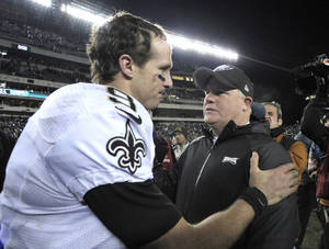 Photo - Philadelphia Eagles head coach Chip Kelly, right, meets with New Orleans Saints' Drew Brees after an NFL wild-card playoff football game, Saturday, Jan. 4, 2014, in Philadelphia. New Orleans won 26-24. (AP Photo/Michael Perez)