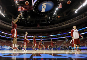 Photo - The Oklahoma Sooners shoot the ball during the practice and press conference day for the second round of the NCAA men's college basketball tournament at the Wells Fargo Center in Philadelphia, Thursday, March 21, 2013. OU will play San Diego State in the second round on Friday. Photo by Nate Billings, The Oklahoman