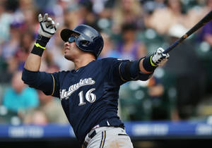Photo - Milwaukee Brewers' Aramis Ramirez follows the flight of his solo home run against the Colorado Rockies in the fifth inning of a baseball game in Denver, Saturday, June 21, 2014. (AP Photo/David Zalubowski)