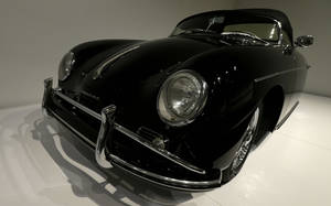 Photo - In this photo taken Wednesday, Oct. 9, 2013 a 1958 Porsche Type 356 Speedster 1600 Super once owned by Steve McQueen is shown on display in the Porsche By Design Seducing Speed exhibit at the North Carolina Museum of Art in Raleigh, N.C. (AP Photo/Gerry Broome)