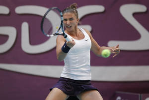 photo - Sara Errani of Italy returns the ball to Kiki Bertens of the Netherlands during the semi final match at the 21st Gaz de France WTA Open 2013 tennis tournament at Coubertin stadium, in Paris, Saturday, Feb. 2, 2013. (AP Photo/Francois Mori)