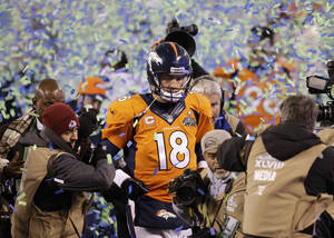 Photo - Broncos quarterback Peyton Manning walks off the field after losing to the Seahawks in the Super Bowl on Sunday. Manning set a Super Bowl record for completions, but also threw two interceptions. AP Photo