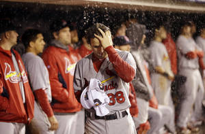 Photo - St. Louis Cardinals' Pete Kozma reacts during the ninth inning of Game 7 of baseball's National League championship series against the San Francisco Giants Monday, Oct. 22, 2012, in San Francisco. (AP Photo/David J. Phillip)  ORG XMIT: NLCS205