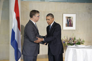 President Barack Obama visits the Dutch Embassy in Washington to sign a book of condolence, joined by Deputy Chief of Mission Peter Mollema, Tuesday, July 22, 2014. Most of the 298 people aboard the Malaysia Airlines plane that was shot down near the border between Ukraine and Russia were Dutch citizens. (AP Photo/J. Scott Applewhite)