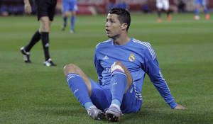 Photo - Real Madrid's Cristiano Ronaldo from Portugal reacts during a La Liga soccer match against Sevilla at the Ramon Sanchez Pizjuan stadium, in Seville, Spain on Wednesday, March 26, 2014. (AP Photo/Angel Fernandez)