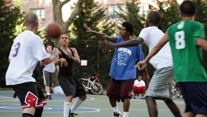 "Photo - This film publicity image released by Doin' It In The Park, LLC shows female basketball player Niki Avery, second left, playing basketball in the Spanish Harlem section of New York during filming of the documentary ""Doin' It In The Park."" (AP Photo/Doin' It In The Park, LLC)"