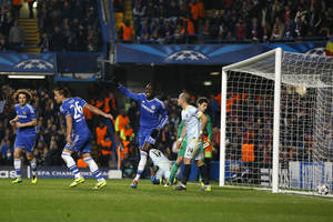 Photo - Chelsea's Demba Ba, centre, celebrates the opening goal during the Champions League Group E soccer match between Chelsea and Steaua Bucharest at Stamford Bridge Stadium  in London Wednesday, Dec. 11, 2013. (AP Photo/Kirsty Wigglesworth)