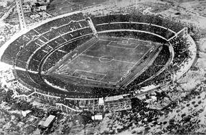 Photo - FILE - In this July 30, 1930 file photo, an aerial view of the Centenario stadium in Montevideo, Uruguay. Uruguay defeated Argentina 4-2 in the World Cup soccer final match. On this day: July 13, 1930 saw the first ever World Cup matches played. France defeated Mexico 4-1, while the US beat Belgium 3-0 at smaller stadiums, in Montevideo. (AP Photo/File)