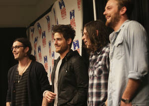 Photo - The Kings of Leon, from left, Nathan, Jared, Matthew and Caleb Followill, accept the 2011 Oklahoma Music Hall of Fame's Rising Star award during a press conference at the BOK Center in Tulsa.  Tulsa World Archive photo